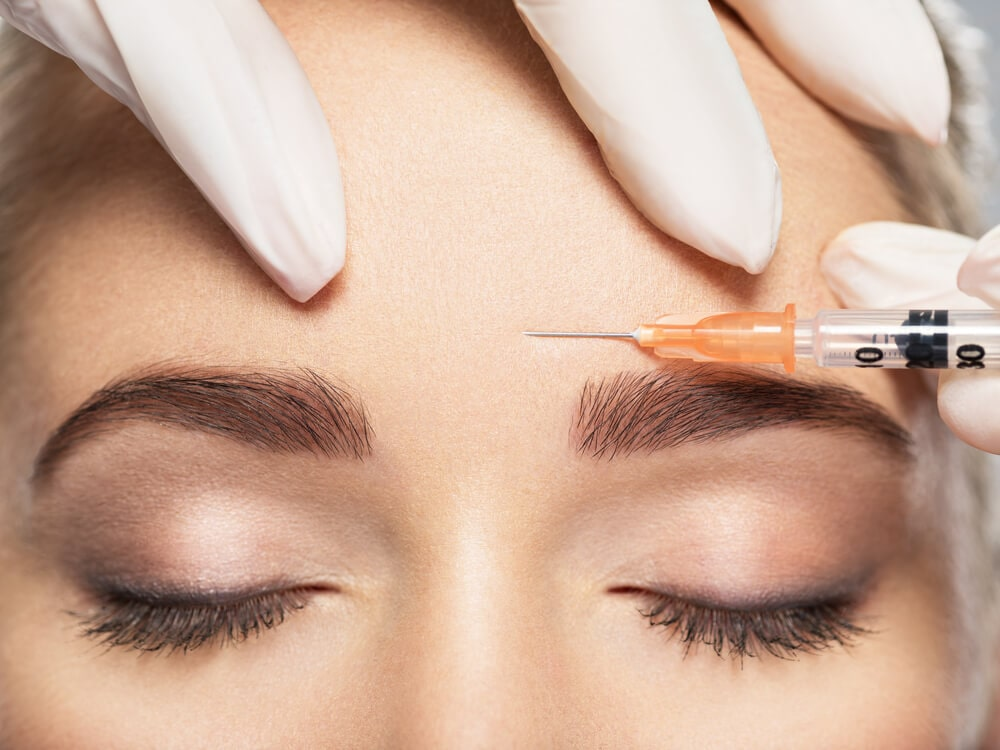 woman getting injection in forehead